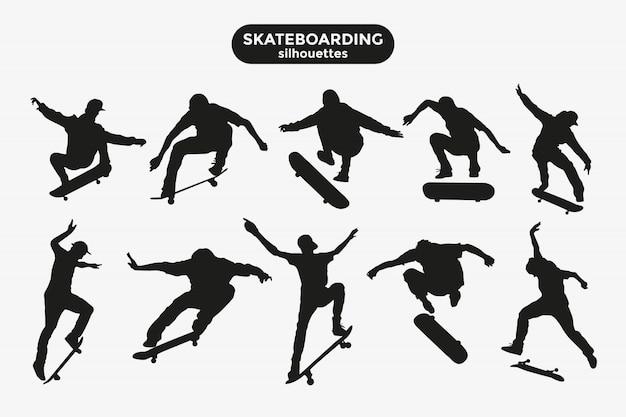 Schwarze schattenbilder von skateboardfahrern auf einem grau Premium Vektoren