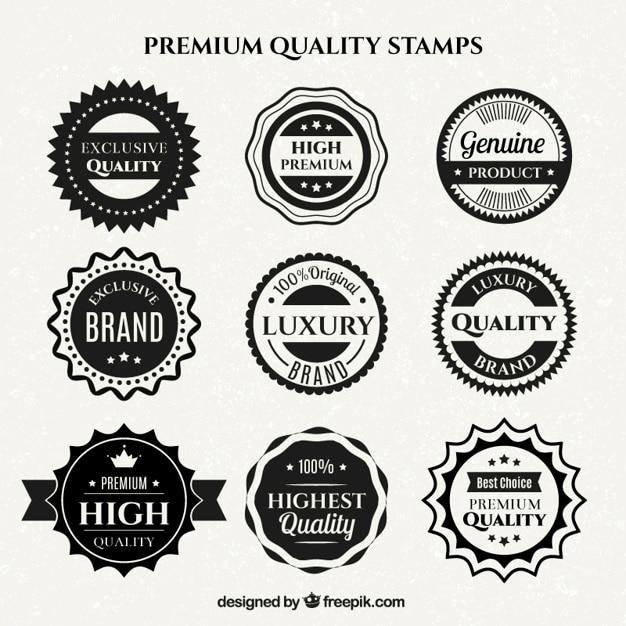 Schwarze und weiße hochwertige abzeichen in flaches design Kostenlosen Vektoren