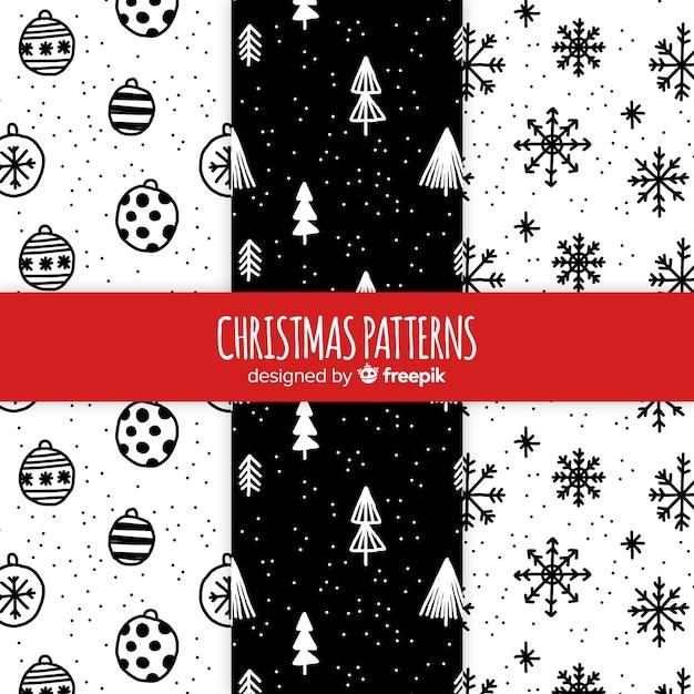 Schwarzweiss-hand gezeichnete weihnachtsmustersammlung Kostenlosen Vektoren