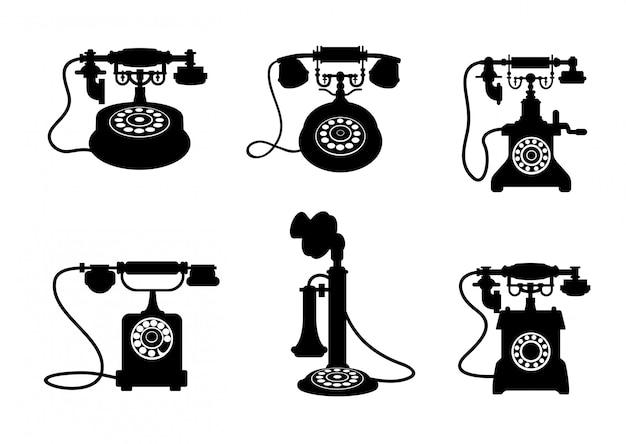 Set retro- und weinlesetelefone lokalisiert auf weißem hintergrund Premium Vektoren