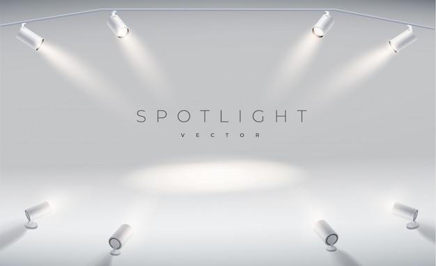 Set strahler realistisch mit hellem weißem licht leuchtenden bühne. Premium Vektoren