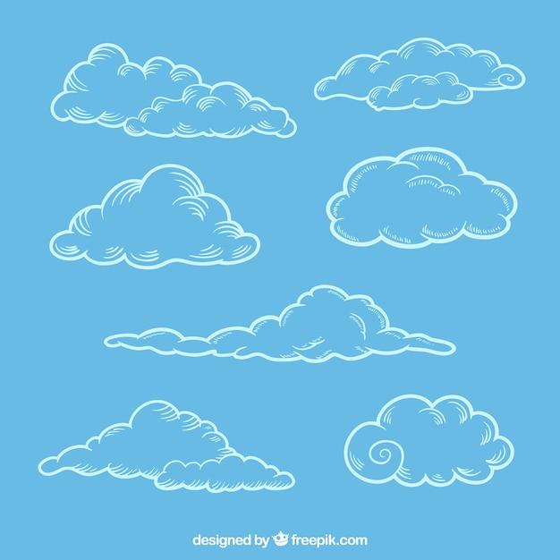 Set von skizzen von flauschigen wolken Kostenlosen Vektoren