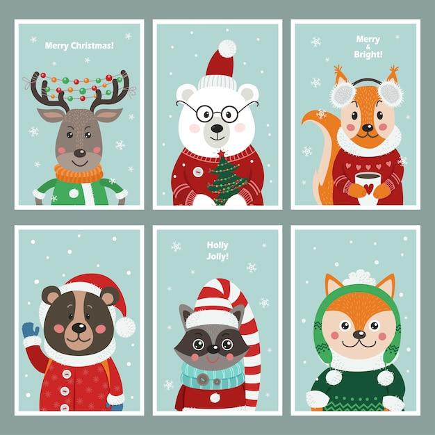 Set weihnachtskarten mit niedlichen waldtieren. Premium Vektoren