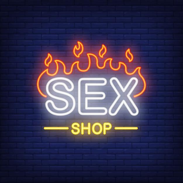 Sex-shop-schriftzug in brand. leuchtreklame auf ziegelsteinhintergrund. Kostenlosen Vektoren