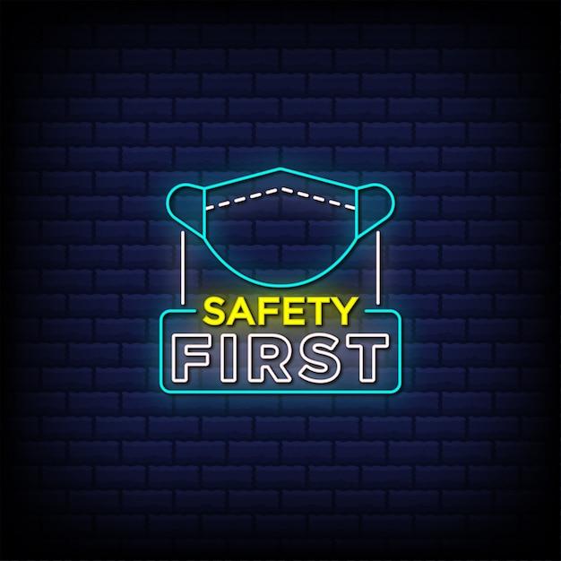 Sicherheit erste leuchtreklame stil text mit gesichtsmaske symbol Premium Vektoren