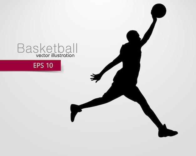 Silhouette eines basketballspielers Premium Vektoren