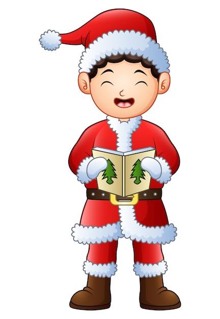 Singende weihnachtslieder des karikaturjungen lokalisiert Premium Vektoren