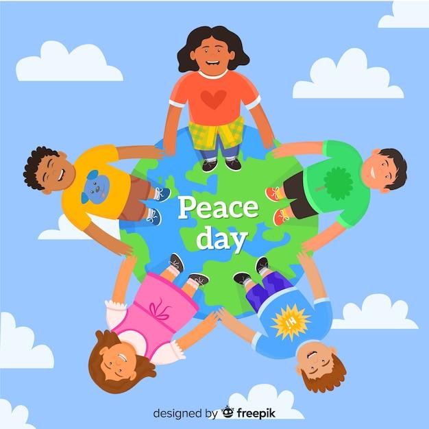 Smileykarikaturkinder vereinigt am friedenstag Kostenlosen Vektoren