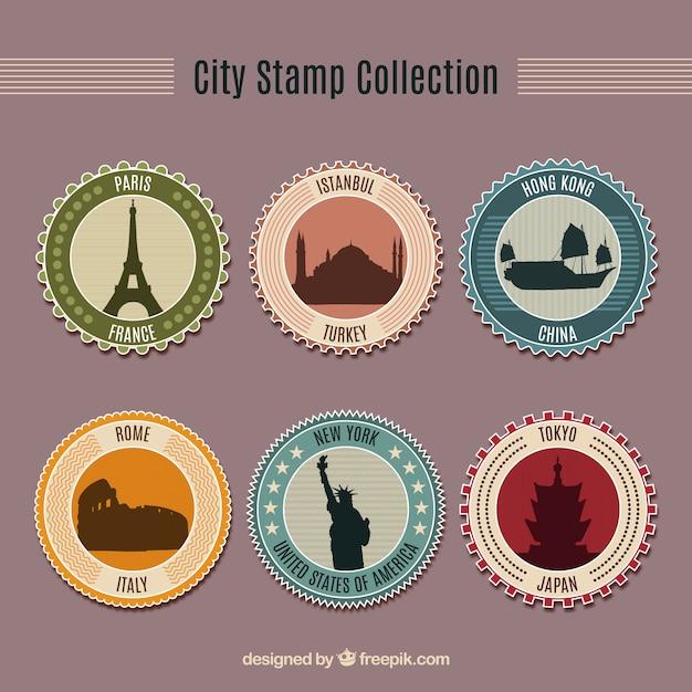 Sortiment von sechs runden briefmarken mit schönen städten Kostenlosen Vektoren