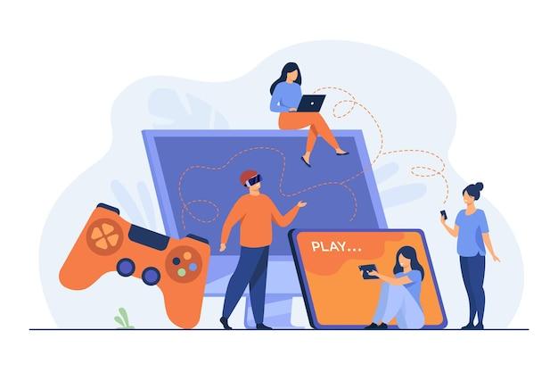 Spieler, die verschiedene geräte verwenden und auf mobiltelefon, tablet, laptop oder konsole spielen. karikaturillustration Kostenlosen Vektoren