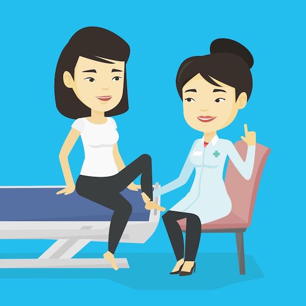 Sportarzt prüft knöchel eines patienten. Premium Vektoren