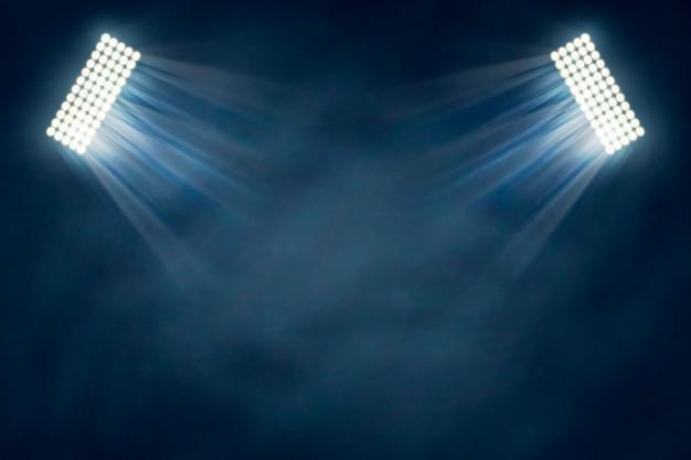 Stadionlichteffekt mit nebel Kostenlosen Vektoren