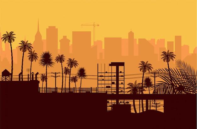 Stadtskylineschattenbild bei sonnenuntergang. Premium Vektoren