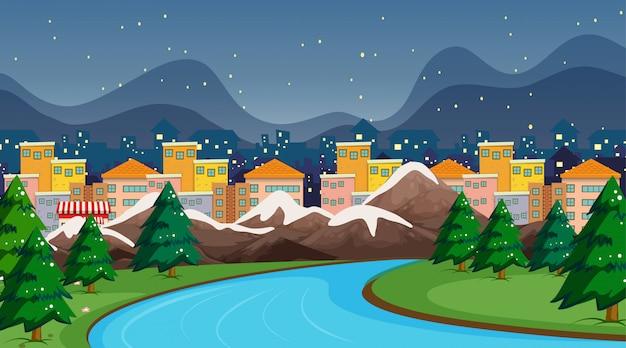 Stadtszene mit fluss und schnee Kostenlosen Vektoren