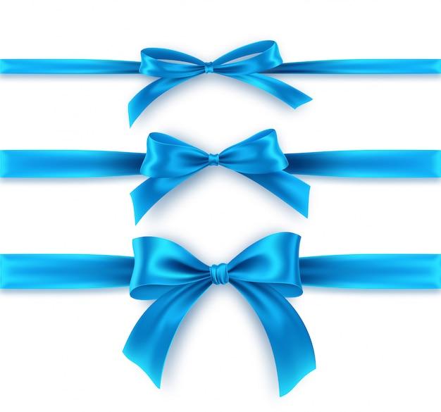 Stellen sie blauen bogen und band auf weißem hintergrund ein. realistische blaue schleife. Premium Vektoren