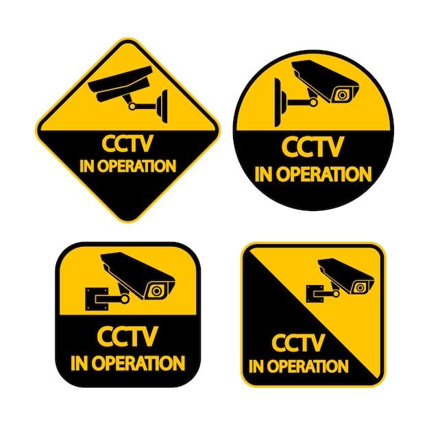 Stellen sie cctv-kamera-label. schwarzes videoüberwachung zeichen Premium Vektoren