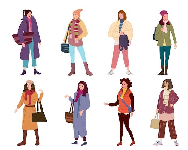 Stellen sie die charaktere der jungen frau in den modischen outwear-frauen der modischen kleidung ein. Premium Vektoren