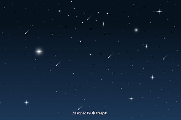 Sternenklare nachthintergrund der steigung mit sternschnuppen Kostenlosen Vektoren