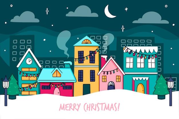 Stille weihnachtsstadtnachthand der vorderansicht gezeichnet Kostenlosen Vektoren