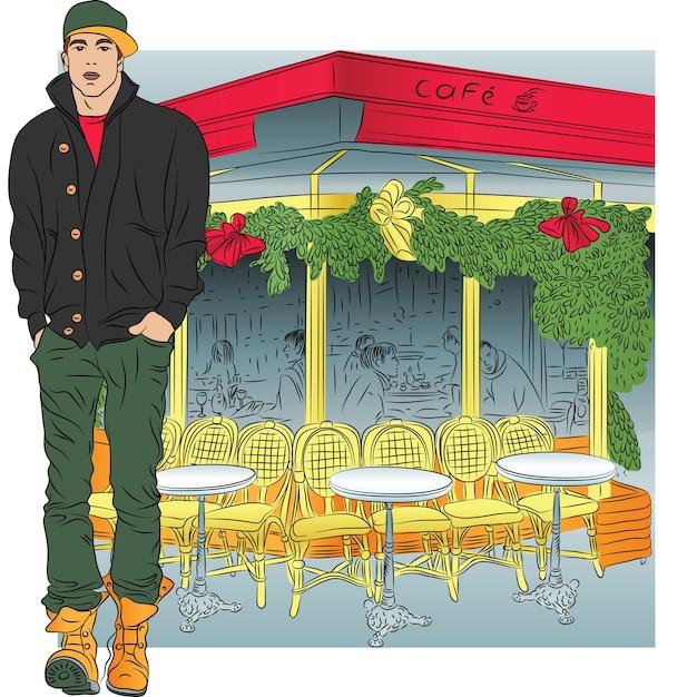 Stilvoller typ in jeans, jacke, stiefeln, mütze im skizzenstil auf dem hintergrund des pariser cafés Premium Vektoren