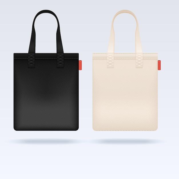 Stoff-tragetaschen in weiß und schwarz Premium Vektoren