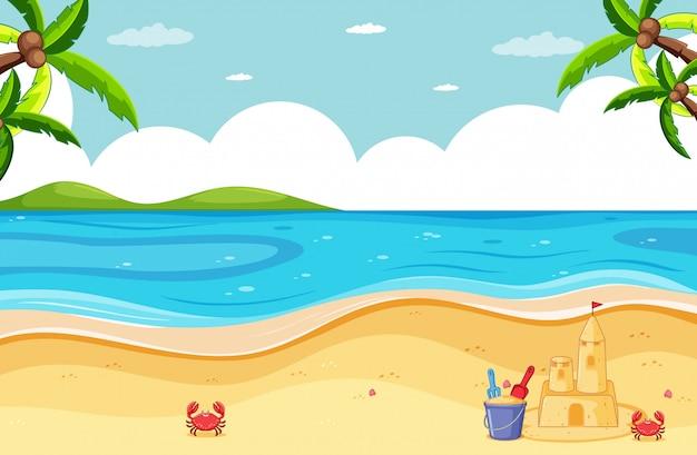 Strandszene mit sandburg und kleiner krabbe Kostenlosen Vektoren