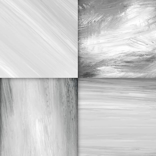 Strukturierter hintergrundvektorsatz des schwarzweiss-acrylbürstenanschlags Kostenlosen Vektoren