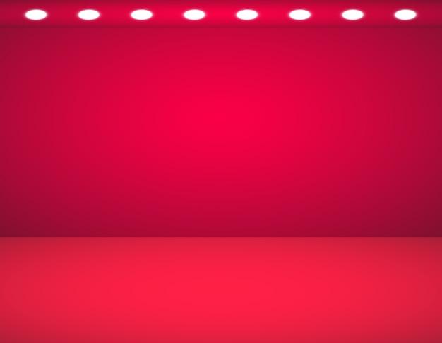 Studio hintergrund. vektor leeres rotes studio mit scheinwerfern Premium Vektoren