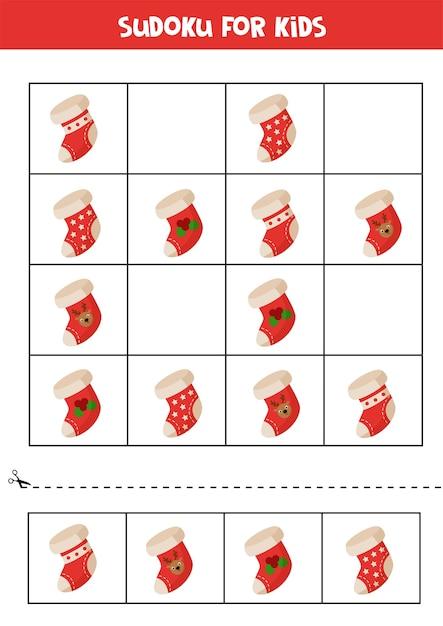Sudoku für kinder mit weihnachtssocken. pädagogisches logisches spiel für kinder. Premium Vektoren