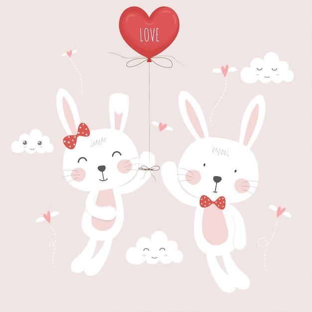 Süß in geliebten kaninchen mit ballon. Premium Vektoren