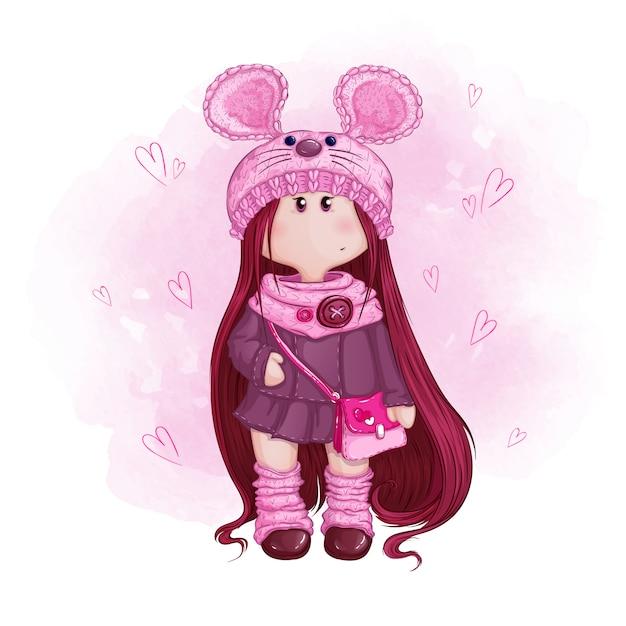 Süße mädchenpuppe mit langen haaren in einer strickmütze mit mäuseohren und einer rosa handtasche. Premium Vektoren