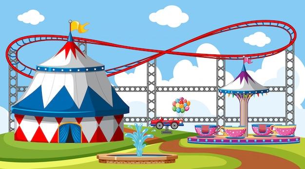 Szene mit achterbahn und großem zirkuszelt im park Kostenlosen Vektoren