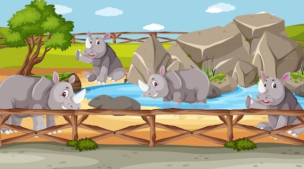 Szene mit wilden tieren im zoo zur tageszeit Premium Vektoren