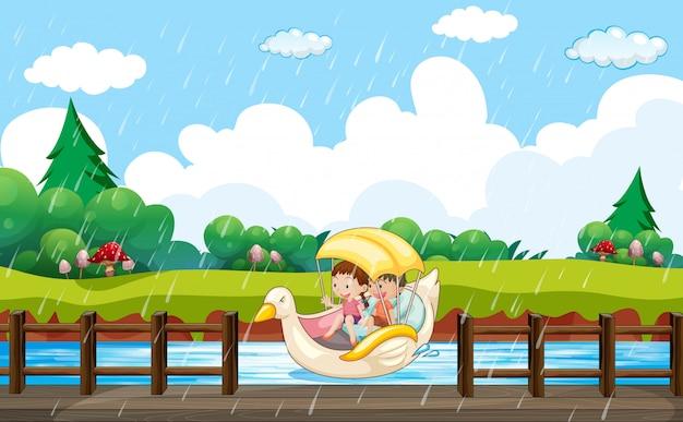 Szenenhintergrunddesign mit kinderpaddeln im entenboot Kostenlosen Vektoren