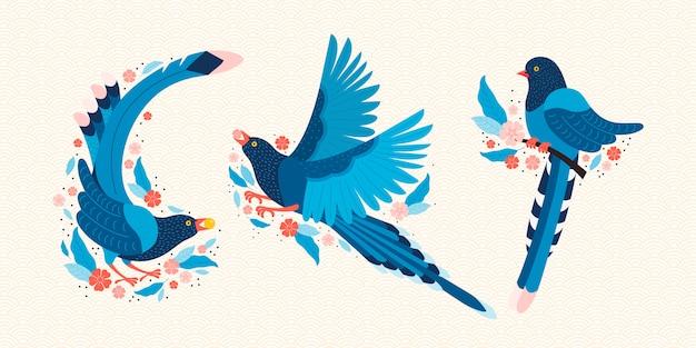 Taiwan blaue elster. symbol von taiwan urocissa caerulea. exotische vögel aus taiwan, china und asien. blauer karikaturvogel und rosa sakurablüten. Premium Vektoren