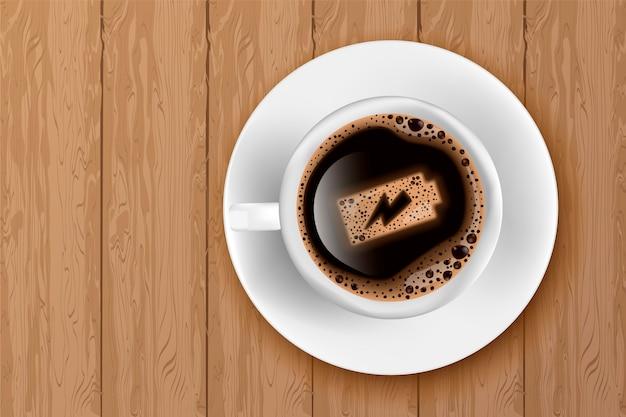Tasse kaffee mit batterieenergie auf schaum Premium Vektoren