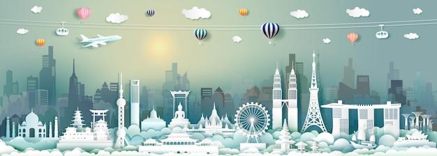 Tavel-architekturmarksteine von asien mit wolkenkratzer und sonnenaufgang im papierschnitt Premium Vektoren