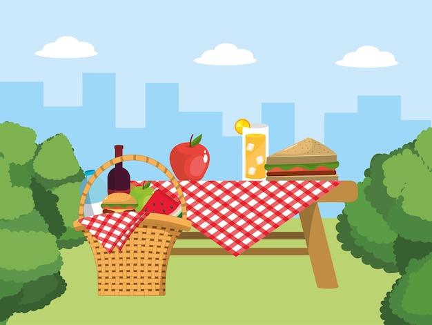 Tisch und korb mit essen und tischdecke dekoration Premium Vektoren