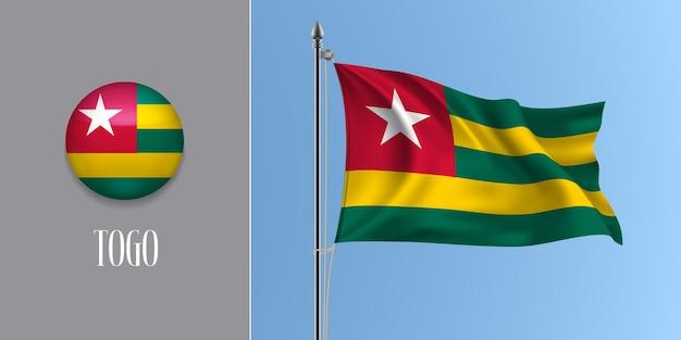 Togo weht fahne am fahnenmast und rund Premium Vektoren