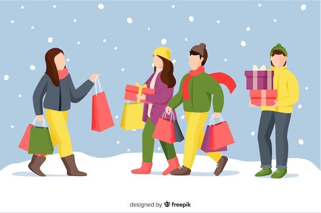 Tragende winterkleidung der karikatur und halten von geschenken im schnee Kostenlosen Vektoren