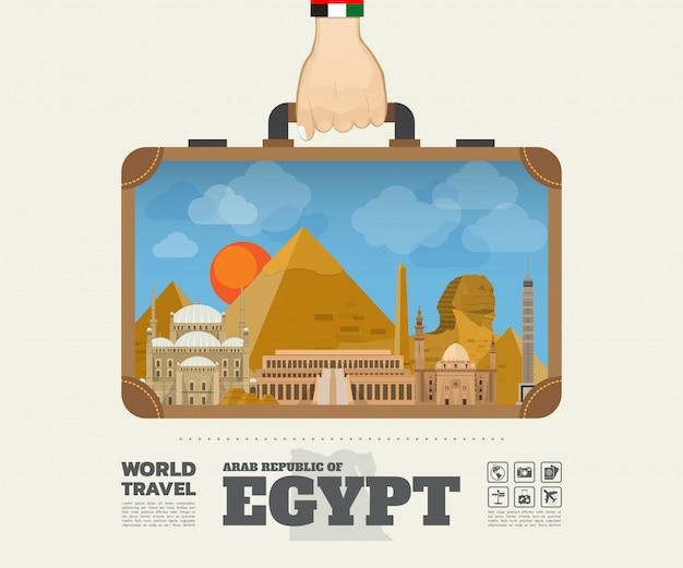 Übergeben sie tragende ägypten-markstein-globale reise und reise infographic-tasche Premium Vektoren