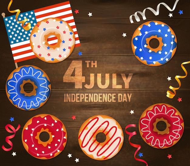 Unabhängigkeitstag der illustration vereinigter staaten von amerika mit staatsflaggeserpentin und verziertem gebäck auf realistischem hölzernem Kostenlosen Vektoren