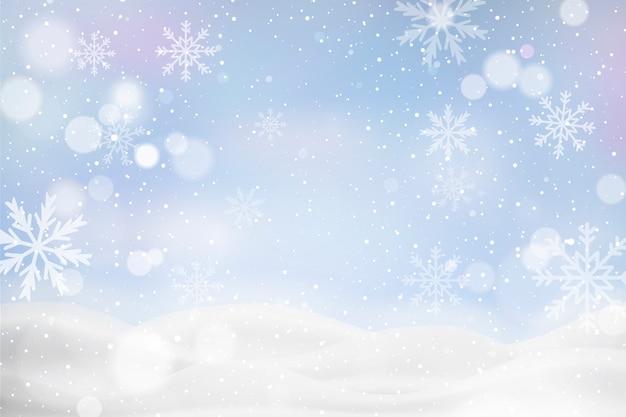 Unscharf winterlandschaft mit schneeflocken Kostenlosen Vektoren