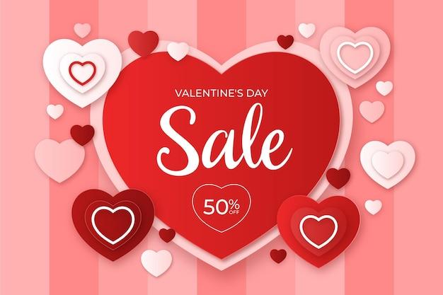 Valentinstag-verkauf im papierstilhintergrund Premium Vektoren