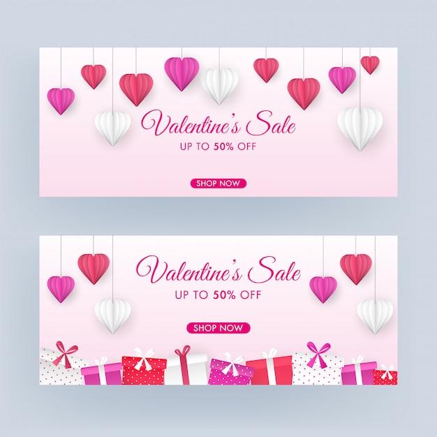 Valentinstag-verkaufs-titel oder fahnen-design-satz mit 50% rabattangebot, origami-papierschnitt-herzen hängen und die geschenkboxen, die auf rosa hintergrund verziert werden. Premium Vektoren