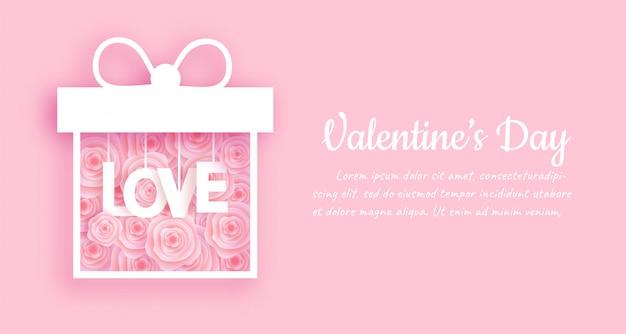 Valentinstagfahne und -hintergrund mit rosafarbenem kasten in der papierschnittart Premium Vektoren