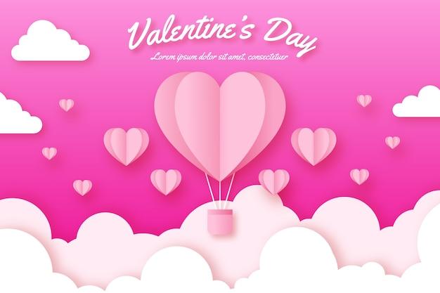Valentinstaghintergrund mit heißem herzen steigt im himmel im ballon auf Kostenlosen Vektoren
