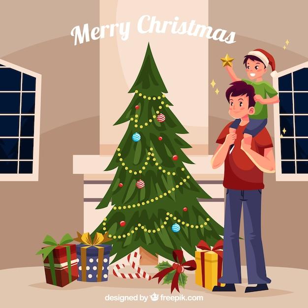 Vater und Sohn schmücken einen Weihnachtsbaum | Download der ...