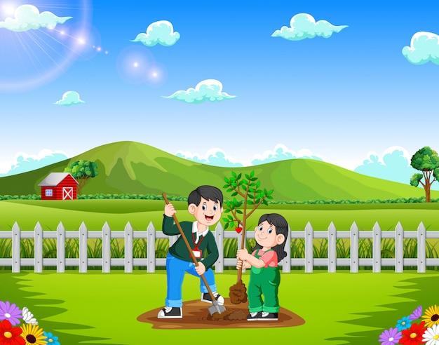 Vater und tochter, die baum im park pflanzen Premium Vektoren