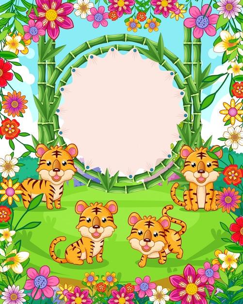 Vector illustration von netten tigern mit bambusfreiem raum unterzeichnen herein den garten Premium Vektoren